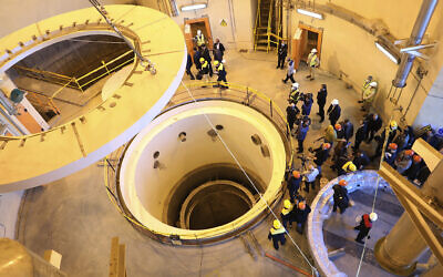 In this photo released by the Atomic Energy Organization of Iran, technicians work at the Arak heavy water reactor's secondary circuit, as officials and media visit the site, near Arak, southwest of the capital Tehran, Iran, Monday, Dec. 23, 2019 (Atomic Energy Organization of Iran via AP)