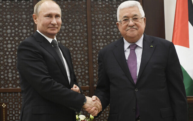 Palestinian President Mahmoud Abbas,  shakes hands with Russian President Vladimir Putin during their meeting at the Palestinian Authority headquarters in Bethlehem, Jan 23, 2020.  (Alexander Nemenov, Pool via AP)