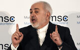 Iranian Foreign Minister Mohammad Javad Zarif speaks on the second day of the Munich Security Conference in Munich, Germany, February 15, 2020. (AP Photo/Jens Meyer)