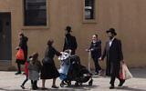 Illustrative: People walk in the Williamsburg neighborhood of Brooklyn, New York, on April 8, 2020. (AP/Mark Lennihan)