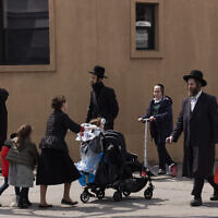 Illustrative: People walk in the Williamsburg neighborhood of Brooklyn, New York, on April 8, 2020. (AP/Mark Lennihan)