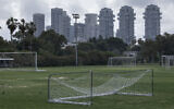 In this March 28, 2020 photo, a closed training soccer field is seen during lockdown following government measures to help stop the spread of the coronavirus in Tel Aviv, Israel (AP Photo/Oded Balilty)