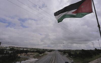 A Jordanian flag over a locked down Amman, Jordan on March 21, 2020. (AP/Raad Adayleh)