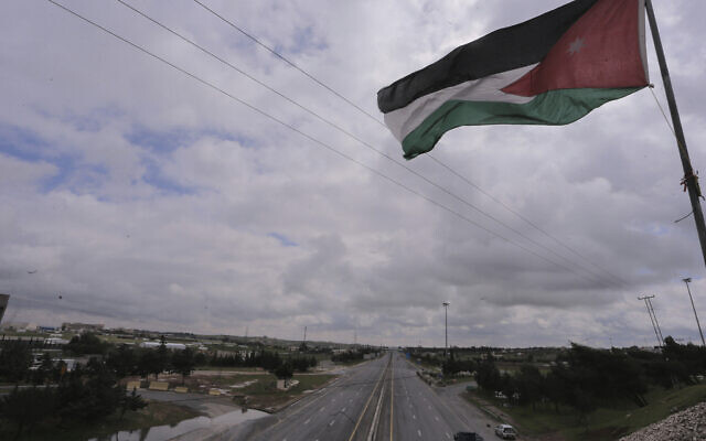 A Jordanian flag over a locked down Amman, Jordan on March 21, 2020. (AP/Raad Adayleh)
