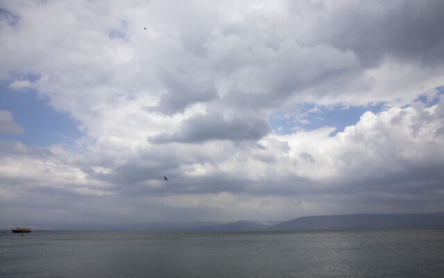 In this April 25, 2020 photo, birds fly while an empty tourist ship is anchored in the Sea of Galilee, locally known as Lake Kinneret (AP Photo/Ariel Schalit)