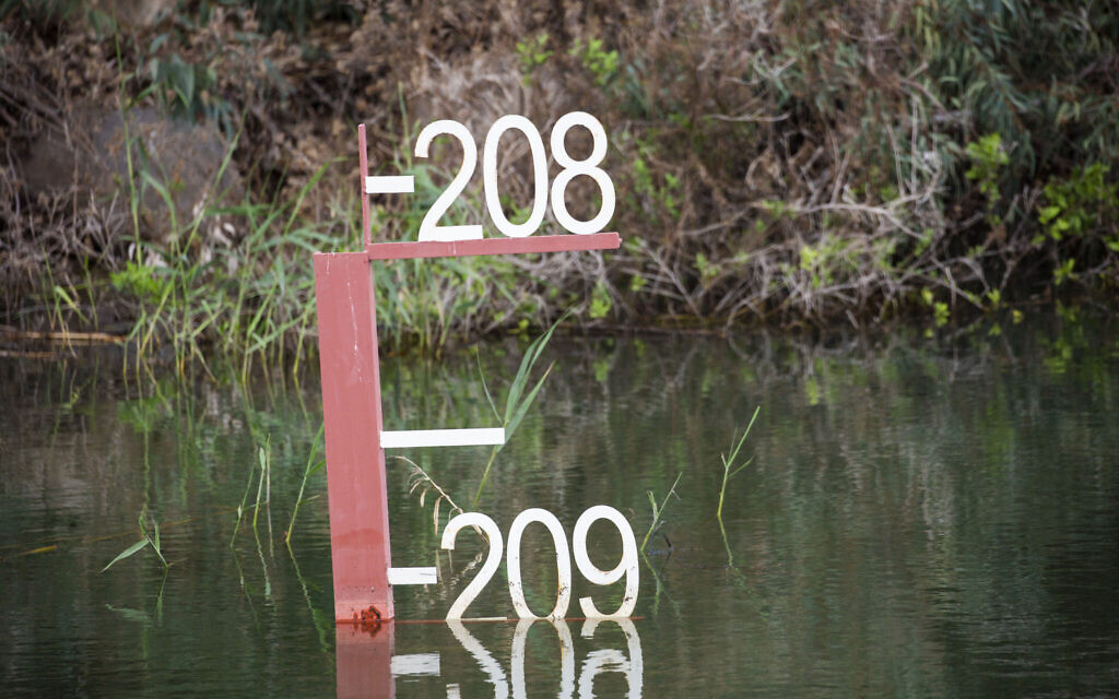 This April 25, 2020 photo shows the sea water level meter in the Sea of Galilee, locally known as Lake Kinneret (AP Photo/Ariel Schalit)
