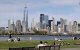 People enjoy the good weather while keeping their distance from one another at Liberty State Park in Jersey City, N.J., Saturday, May 2, 2020. (AP/Seth Wenig)