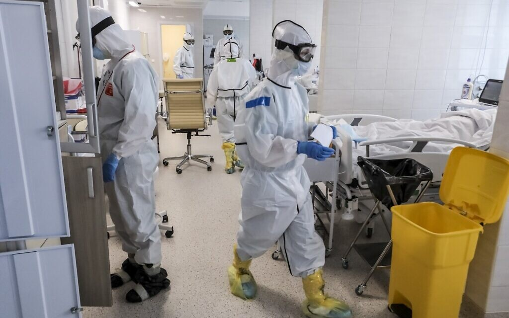In this photo taken on May 2, 2020, doctors work inside the intensive care unit for people infected with the new coronavirus, at a hospital in Moscow, Russia. (AP Photo/Sophia Sandurskaya)