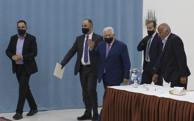 Palestinian Authority President Mahmoud Abbas arrives to head the Palestinian leadership meeting at his headquarters, in the West Bank city of Ramallah on May 5, 2020. (AP/Nasser Nasser, Pool)