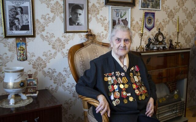 Valentina Efremova, a 96-year-old World War II veteran, who served as a nurse in field hospitals on the frontlines throughout the war, speaks during her interview with the Associated Press in Yakutsk, Russia, April 30, 2020 . (AP Photo/Alex Lee)