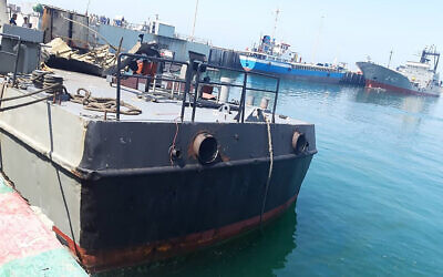 In this photo provided May 11, 2020, the Konarak support vessel which was struck during a training exercise in the Gulf of Oman, is docked in an unidentified naval base in Iran (Iranian Army via AP)