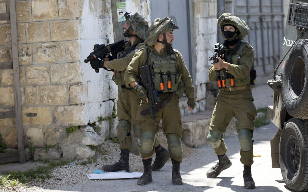Israeli troops patrol in the northern West Bank village of Yabad after a soldier was killed there during a raid, May, 12, 2020. (AP/Majdi Mohammed)