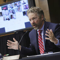 Sen. Rand Paul, Republican of Kentucky, speaks during a virtual Senate Committee for Health, Education, Labor, and Pensions hearing, Tuesday, May 12, 2020 on Capitol Hill in Washington. (Win McNamee/Pool via AP)
