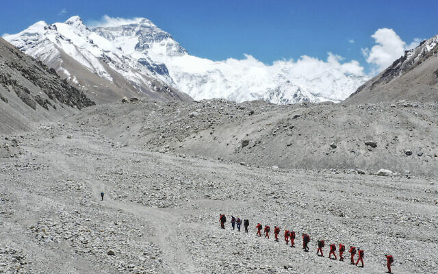 Chinese surveyors hike toward a higher spot from the base camp on Mount Everest at an altitude of 5,200 meters, May 16, 2020. (Jigme Dorje/Xinhua via AP)