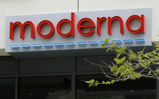 A sign marks an entrance to a Moderna, Inc., building, Monday, May 18, 2020, in Cambridge, Mass. (AP Photo/Bill Sikes)