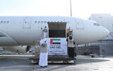 In this photo released by the state-run WAM news agency on May 19, 2020, an Etihad Airways flight with aid for the Palestinians to fight the coronavirus pandemic is loaded with its cargo in Abu Dhabi, United Arab Emirates. (WAM via AP)