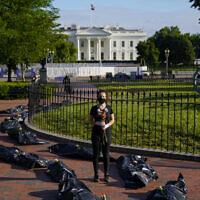 Margot Bloch, of Takoma Park, Md., participates in a protest over President Trump's handling go the coronavirus pandemic, in Lafayette Park across the street from the White House in Washington, Wednesday, May 20, 2020.(AP/Evan Vucci)