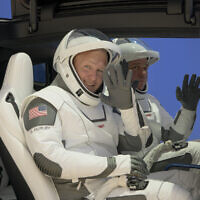 NASA astronauts Douglas Hurley, left, and Robert Behnken, wearing SpaceX spacesuits, depart the Neil A. Armstrong Operations and Checkout Building for Launch Complex 39A during a dress rehearsal prior to the Demo-2 mission launch on May 23, 2020, at NASA's Kennedy Space Center in Cape Canaveral, Florida. (Bill Ingalls/NASA via AP)