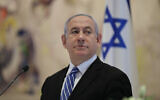 Prime Minister Benjamin Netanyahu attends the first Cabinet meeting of the new government in the Knesset, on May 24, 2020. (Abir Sultan/Pool Photo via AP)
