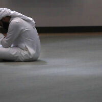 A man bows his head during prayers in an empty mosque in Plano, Texas, May 24, 2020. (LM Otero/AP)