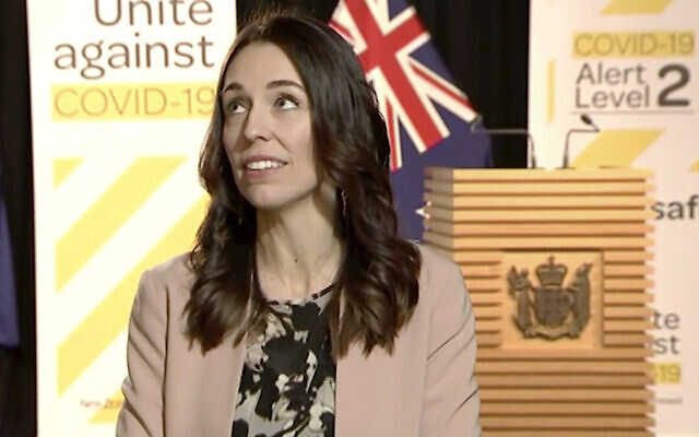 In this image made from video, New Zealand Prime Minister Jacinda Ardern looks up when an earthquake struck during a live television interview in Wellington, New Zealand, May 25, 2020 (Newshub via AP)