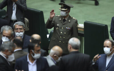 Commander of the Iranian Army Gen. Abdolrahim Mousavi wears a protective face mask to help prevent the spread of the coronavirus waves as he arrives for the inauguration of the new parliament, in Tehran, Iran, May, 27, 2020. (Vahid Salemi/AP)