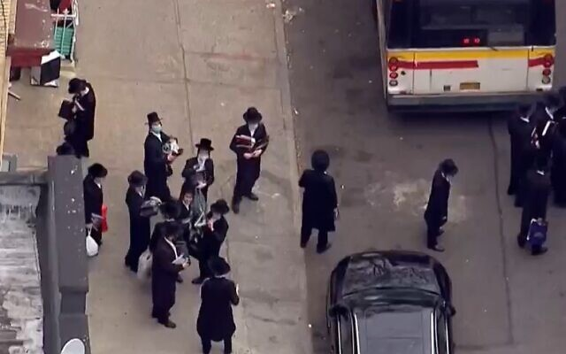 Students leave a yeshiva in Brooklyn after police shut it down for violating coronavirus social distancing regualtions on May 18 2020 (Screencapture/  WNBC-TV)