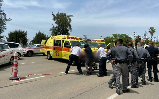 Medics at the scene of a stabbing outside the Sheba Medical Center in Tel Hashomer on May 13, 2020. (Magen David Adom)