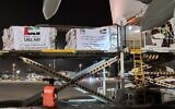 An Etihad Airways flight with aid for the Palestinians to fight the coronavirus pandemic is unloaded at Ben Gurion Airport on May 19, 2020. (Nickolay Mladenov/Twitter)