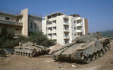 IDF tanks near houses in the southern Lebanese city of Tyre on July 22, 1982. (Yossi Zamir/Flash90)