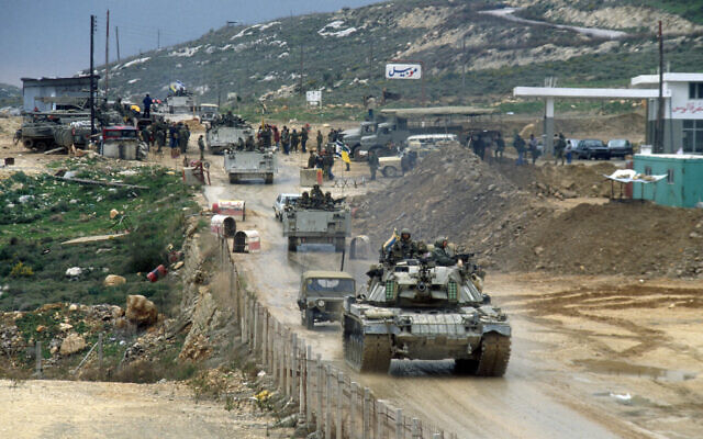 IDF vehicles drive over the Awali bridge as they leave Lebanon on the first day of a planned retreat on February 16, 1985. (Yossi Zamir/Flash90)