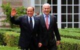 File: Benjamin Netanyahu, right, meets with then-Italian Prime Minister Silvio Berlusconi in Rome on June 13, 2011. (Amos Ben Gershom / GPO/FLASH90)