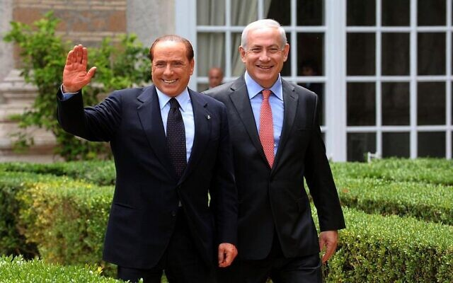 File: Benjamin Netanyahu, right, meets with then-Italian Prime Minister Silvio Berlusconi in Rome on June 13, 2011. (Amos Ben Gershom / GPO/FLASH90)