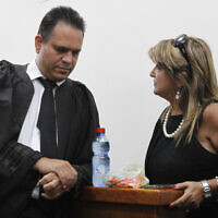 Attorney Micha Fetman (L) in the District Court in Jerusalem on September 05, 2011 with his client Shula Zaken (Miriam Alster/FLASH90)