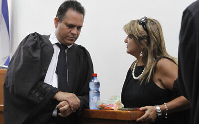 Attorney Micha Fettman (L) in the District Court in Jerusalem on September 05, 2011 with his client Shula Zaken (Miriam Alster/FLASH90)