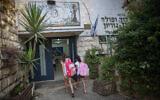 ILLUSTRATIVE -- Children arrive at Paula Ben Gurion elementary school in Jerusalem on September 1, 2015 (Hadas Parush/Flash 90)