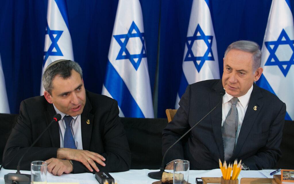 Prime Minister Benjamin Netanyahu (R) sits with then-minister Ze'ev Elkin during a special cabinet meeting for Jerusalem Day at the Ein Lavan spring in Jerusalem, June 2, 2016. (Marc Israel Sellem/Pool)