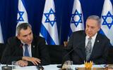 Prime Minister Benjamin Netanyahu (R) sits with Minister Zeev Elkin during a special cabinet meeting for Jerusalem day at the Ein Lavan spring in Jerusalem, June 2, 2016. (Marc Israel Sellem/POOL)