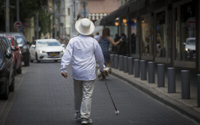 Illustrative: A blind man walks in Tel Aviv on July 23, 2016. (Nati Shohat/Flash90)
