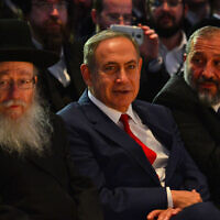 Prime Minister Benjamin Netanyahu (center), Interior Minister Aryeh Deri (right) and then-health minister Yaakov Litzman (left) attend a conference in Lod on November 20, 2016. (Kobi Gideon/GPO)