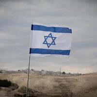 An Israeli flag is seen in the E1 area of the West Bank on January 2, 2017. (Yonatan Sindel/Flash90)