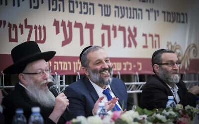 Interior Minister Aryeh Deri (C), then-health minister Yaakov Litzman (L) and United Torah Judaism MK Moshe Gafni attend the third annual Shas conference at the Ramada Hotel in Jerusalem on February 16, 2017. (Yonatan Sindel/Flash90)
