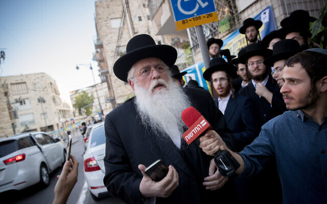 Deputy Education Minister Meir Porush of United Torah Judaism arrives for a meeting of the party's Council of Torah Sages over the military draft law, in Jerusalem on October 14, 2018. (Yonatan Sindel/Flash90)