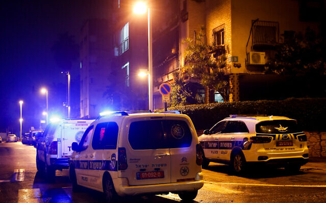Illustrative: Police and medical personnel at the scene of a suspected murder-suicide in Petah Tikva on January 17, 2020. (Roy Alima/Flash90)