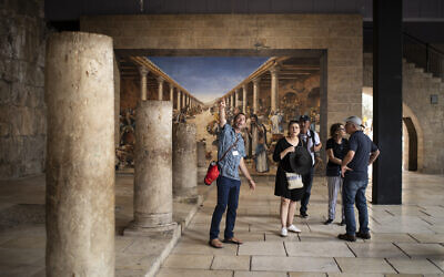 Tourists and their guide at the Cardo in the Jewish Quarter of Jerusalem's Old City in July 2019, months before the coronavirus would shutter Israeli tourism (Hadas Parush/Flash 90)