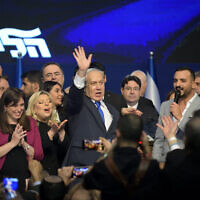 Prime Minister Benjamin Netanyahu, center, is flanked by Likud lawmakers at the party's post-election event in Tel Aviv, on March 2, 2020. (Gili Yaari/Flash90)