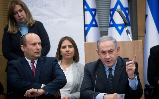 Prime Minister Benjamin Netanyahu speaks with then-defense minister and Yamina leader Naftali Bennett during a meeting with the heads of right-wing parties in the Knesset on March 4, 2020. (Yonatan Sindel/Flash90)