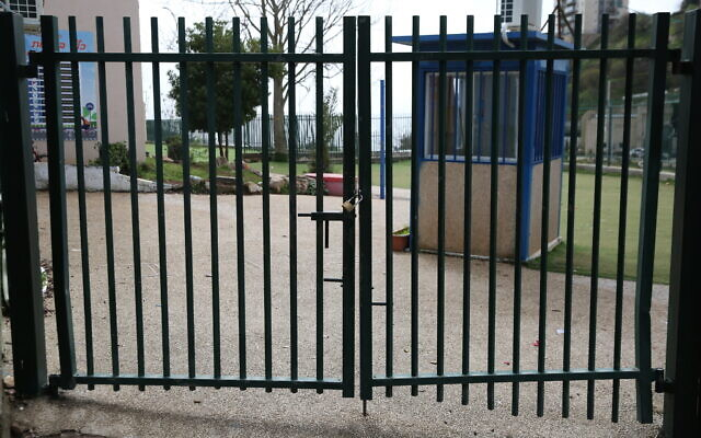 The closed gates of a school in Safed, northern Israel,  March 13, 2020.  (David Cohen/Flash90)
