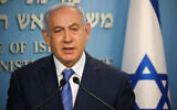 Prime Minister Benjamin Netanyahu gives a televised statement at the Prime Minister's office in Jerusalem on March 25, 2020. (Olivier Fitoussi/Flash90)