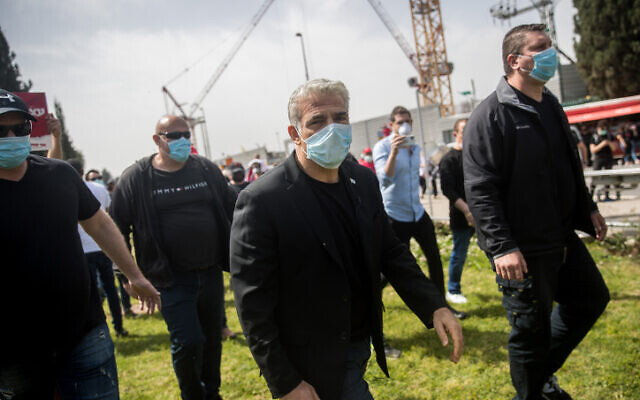 Yair Lapid at a rally of self-employed and kindergarten owners outside the Knesset in Jerusalem, on April 19, 2020. (Yonatan Sindel/Flash90 )